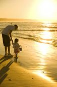 pic of summer beach  - Father and Daughter playing at the beach - JPG