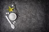Top View Of White Granulated And Cubes Sugar With Vanilla Sticks And Flower poster