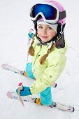 Skiing, portrait of cute skier on ski slope