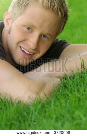 Young Male Smiling On Grass