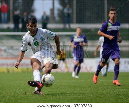 KAPOSVAR, HUNGARY - SEPTEMBER 14: Pedro Sass (in white) in action at a Hungarian National Championship soccer game - Kaposvar (white) vs Ujpest (purple) on September 14, 2012 in Kaposvar, Hungary.