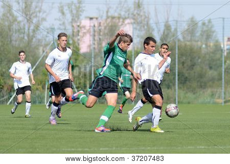 KAPOSVAR, HUNGARY - SEPTEMBER 22: Unidentified players in action at the Hungarian National Championship under 17 game between Kaposvar (green) and Gyor (white) September 22, 2012 in Kaposvar, Hungary.
