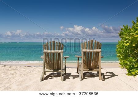 Resting Chairs On The Beautiful Sandy Beach Near The Sea