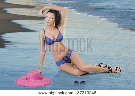 Pretty Brunette In Blue Bikini With Arm On The Head