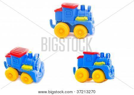 Conjunto. Juguete que un infantiles de plástico, una locomotora de brillantes tonos de vapor.