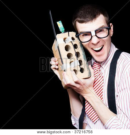 Business Geek Laughing On House Brick Phone