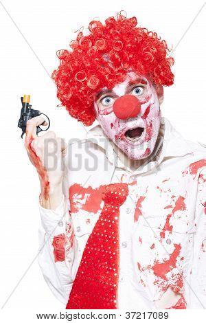 Evil Clown Holding Cap Gun On White Background