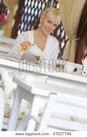 young beautiful smiling woman in street cafe - restaurant