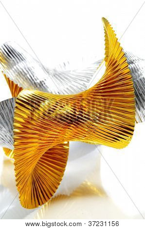 undulating golden and silver garland on a white background