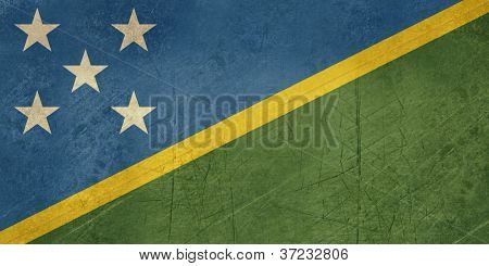 Grunge sovereign state flag of country of Solomn Islands in official colors.