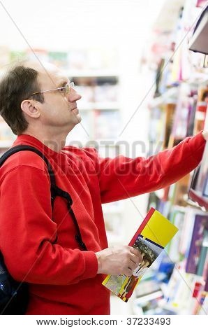 Male customer reading in a book store