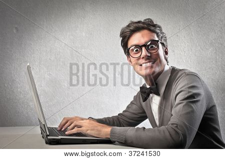 Fashionable man using a laptop computer