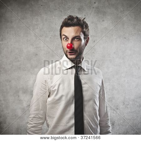 Businessman with a red clown nose