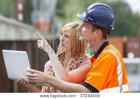 Businesswoman and worker with laptop