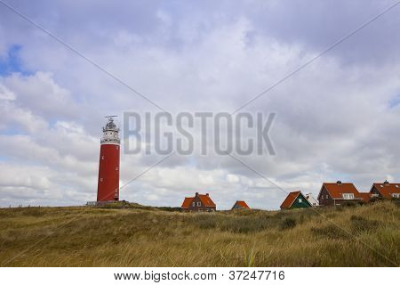 Red Lighthouse And Houses On Island Texel, The Netherlands