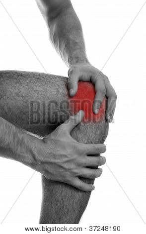 Close Up View Of Male Hands Holding His Sore Knee. Isolated On White. Black And White