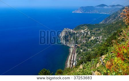 Cinque Terre National Park, View to Corniglia town from mountain at sunny day. Italy