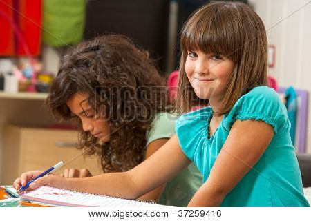 Cute Girl Doing Schoolwork At Home.