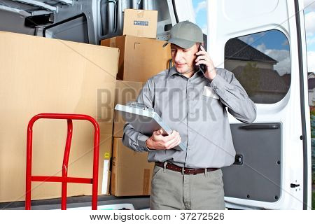 Happy professional shipping courier. Delivery postal service.