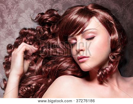 girl with wonderful red curly and shiny hair