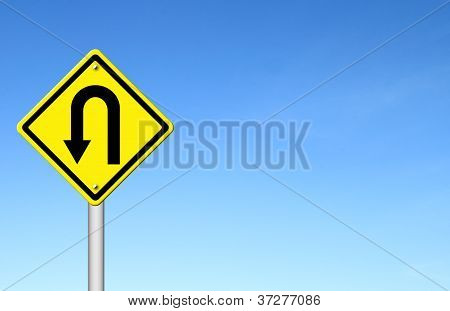 Yellow Warning Sign U-turn Roadsign With Blue Sky Background