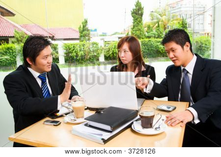 Group Of Business People In Heavy Discussion