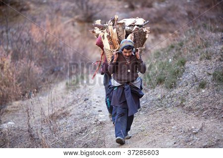 Gorkhas Men Carry Heavy Basket In The Himalaya