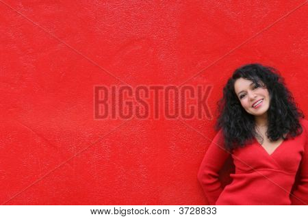 Girl Wearing Red On Red Wall