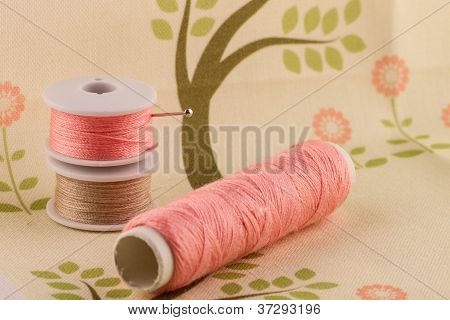 Pink Thread On Fabric