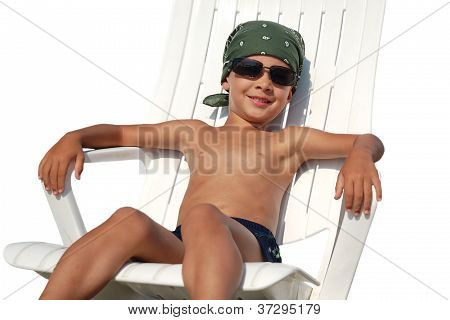 Happy Child In Deckchair Isolated On White Background