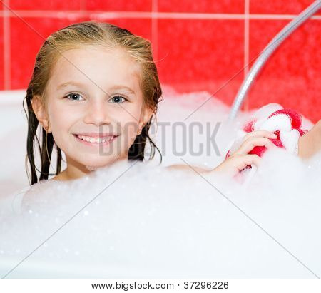 Little girl in the bath with a wisp