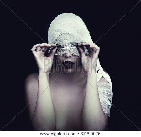 woman in bandage over black background (gothic style concept)