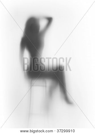 Diffuse sitting woman silhouette