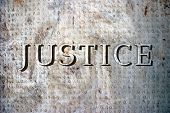 picture of supreme court  - the word justice on a marble plaque with ancient greek inscriptions.  - JPG