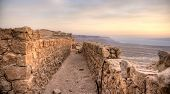 stock photo of masada  - Masada fortress and Dead sea sunrise in Israel judean desert tourism - JPG