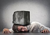 picture of gravity  - Businessman crushed by a boulder - JPG