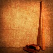 stock photo of baseball bat  - A photoshop generated background of a baseball bat and glove - JPG