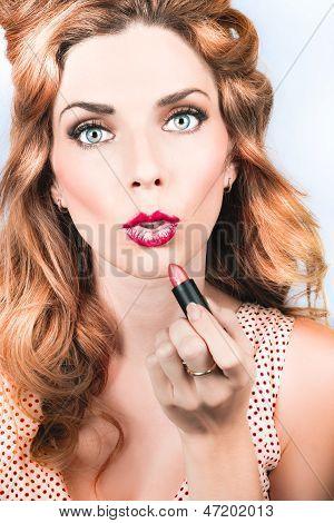Retro Beauty Pin Up Girl Applying Lipstick Makeup