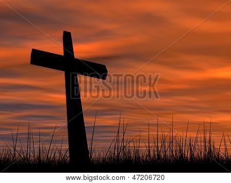 Concept conceptual black cross or religion symbol silhouette in grass over a sunset or sunrise sky with sunlight clouds background