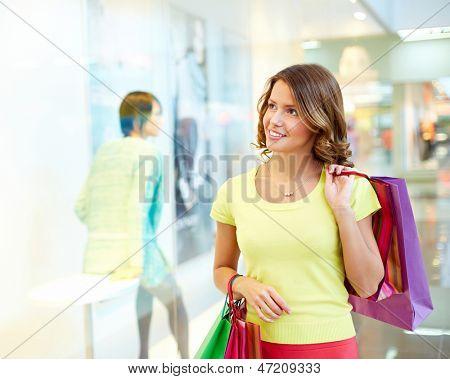 Young woman admiring shop-window