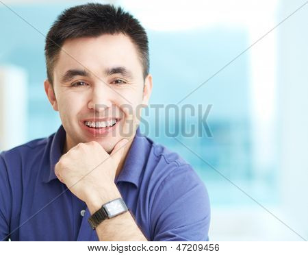 Portrait of cheerful businessman looking at camera with smile