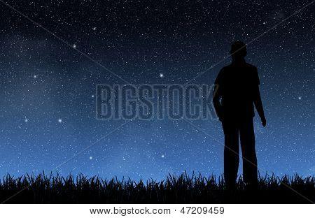 Man under the night sky