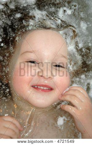 Little Girl Floating In Bath