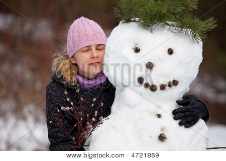 Woman Posing With Snowman