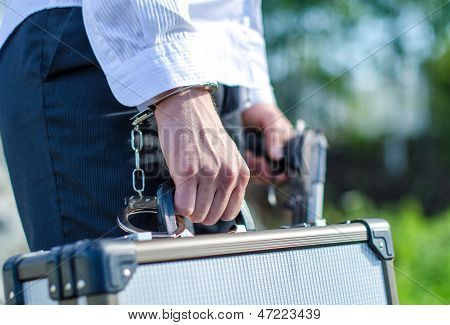 Close Up View Of Male Hand Enchained To Suitcase
