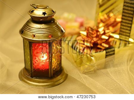 Arabic lantern with gifts at background