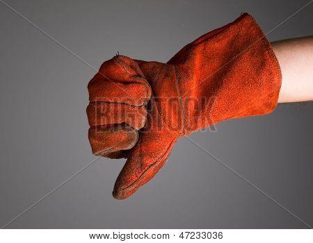 Hand Expressing Negativity With Welder Glove