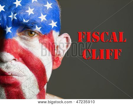 Man's Face Painted With Flag Of Usa, Sad Expression And  Fiscal Cliff.