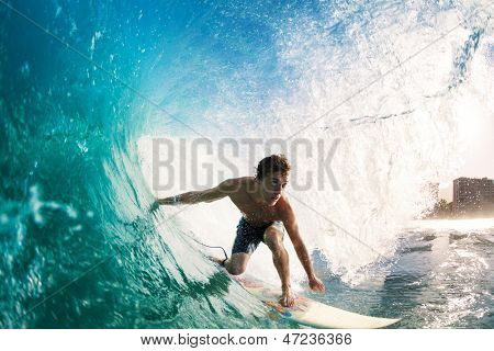 Surfer on Blue Ocean Wave Getting Barreled