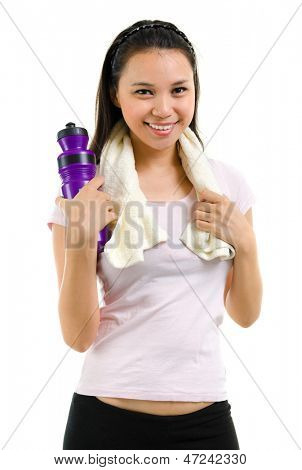 Fitness woman woman with bottle of water after workout. Mixed race Southeast Asian Caucasian fitness girl holding water bottle and towel after training isolated on white background.